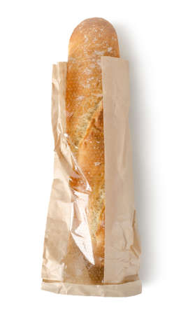 Fresh baguette in a paper bag