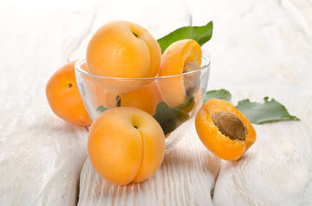Apricots on a wooden background photo