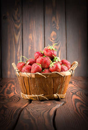 Strawberries in a basket Stock Photo - 14460750
