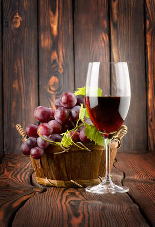 Wine glass and grapes in a basket photo