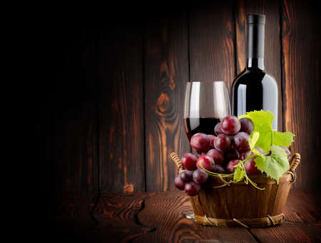 Wine on the old wooden background photo
