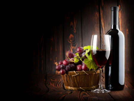Wine on the dark wooden background photo