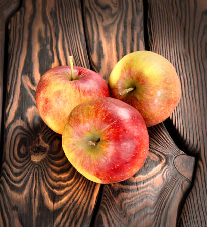 Red apples on the wooden table photo