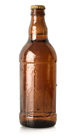 brown bottle: Beer in a brown bottle isolated