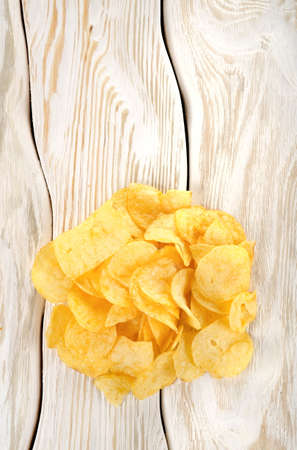 saturated color: Potato chips on a white table