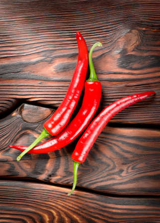 cayenne: Chili on a wooden background