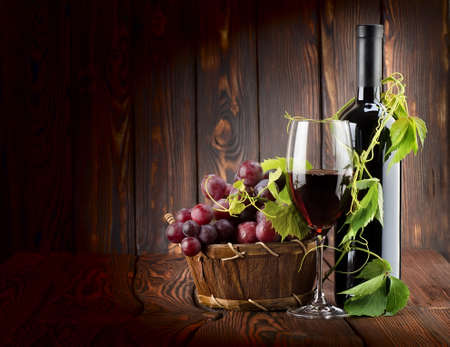 Wine set on wooden background photo