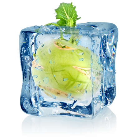 solid food: Ice cube and kohlrabi Stock Photo