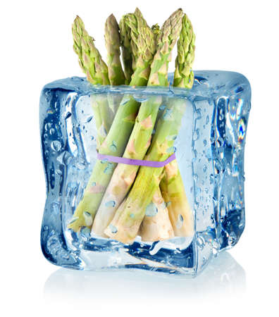 Ice cube and asparagus Stock Photo