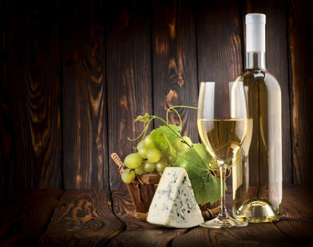 White wine and blue cheese photo