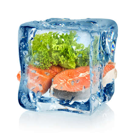 Frozen meat: Ice cube and fish Stock Photo