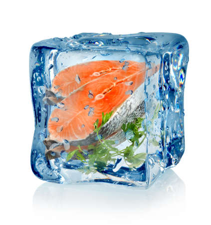 frozen fish: Ice cube and fish with parsley