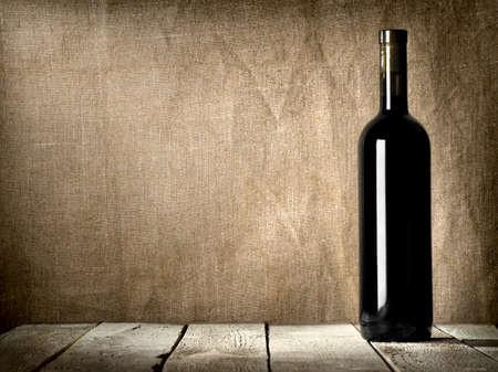 alcohol bottle: Black bottle of wine