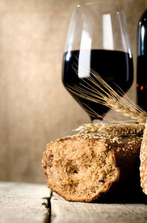 Wine, bread and wheat photo