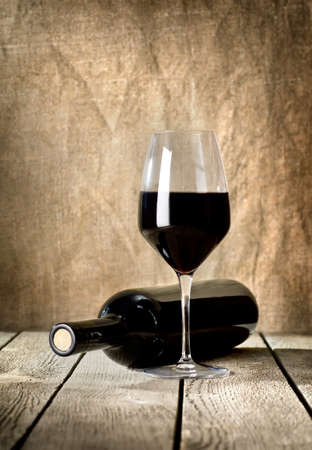 Black bottle of wine and wneglass photo