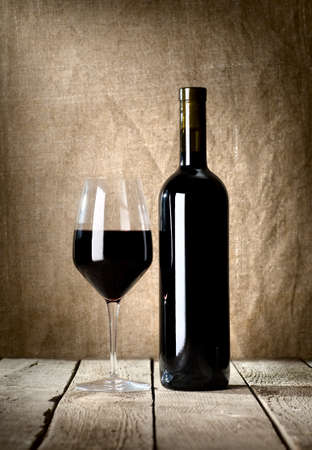 Black bottle and glass photo