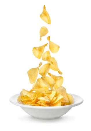 grasas saturadas: Las papas fritas que cae en el plato Foto de archivo