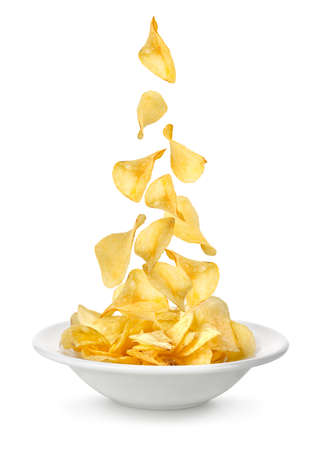 Potato chips falling in the plate photo