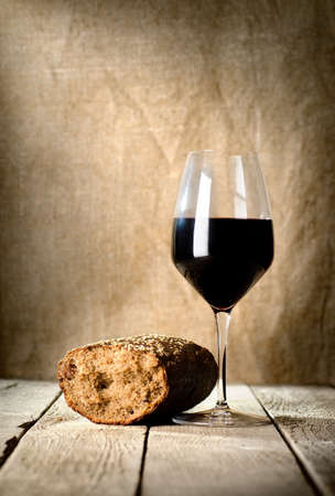 Wine glass and bread photo