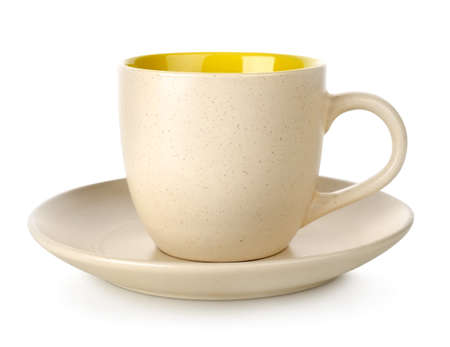 Yellow cup and saucer Stock Photo - 17817430