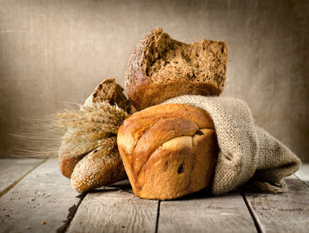 Bread in assortment and wheat photo