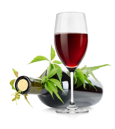 Wineglass and wine bottle with vine photo