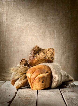 Bread assortment on background of the old canvas photo