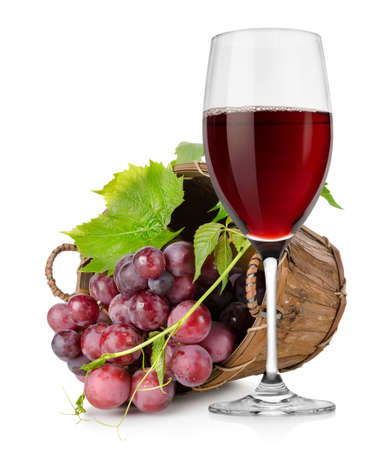 Wineglass and  grapes in a basket photo