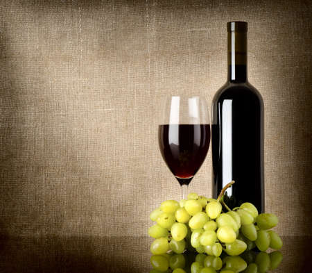 Dry red wine and grapes photo