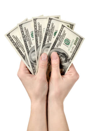 Hands holds hundreds of dollars photo