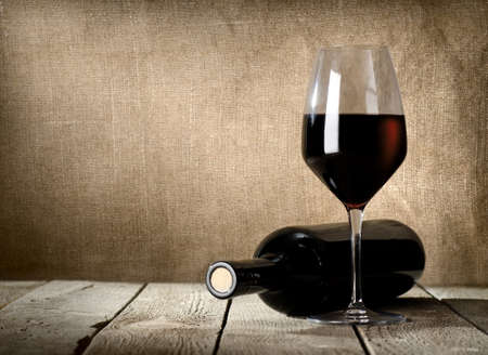 glass of red wine: Black bottle and red wine