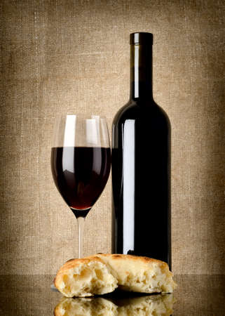 burlap background: Wine and  bread on canvas Stock Photo
