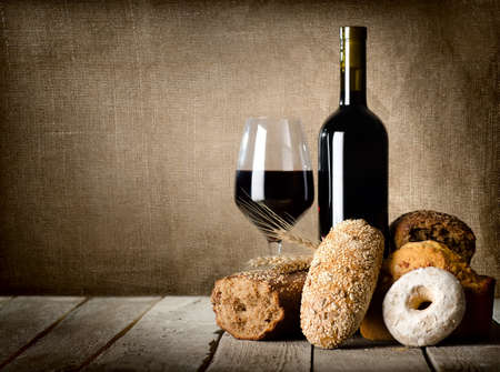 Red wine and assortment of bread photo