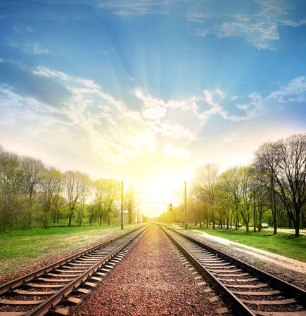 Railway tracks in a rural scene with nice pastel sunset Banco de Imagens