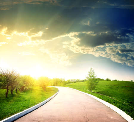 over the hill: Asphalted road to the sun Stock Photo