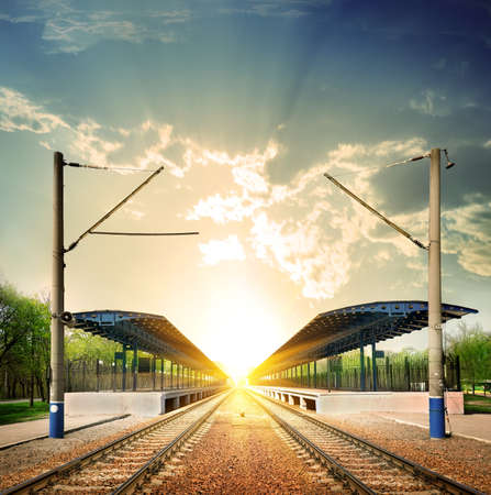 railway track: Railway station at sunset in sunlight