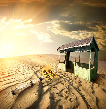 swamped: Bus stop in the desert at sunset