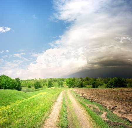 Country road and storm clouds photo