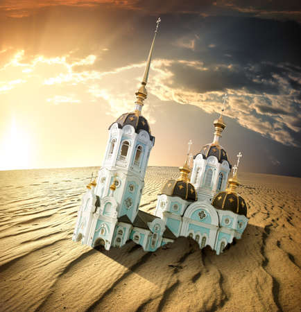 devastation: Church in the sands of the desert at sunset. Doomsday Stock Photo