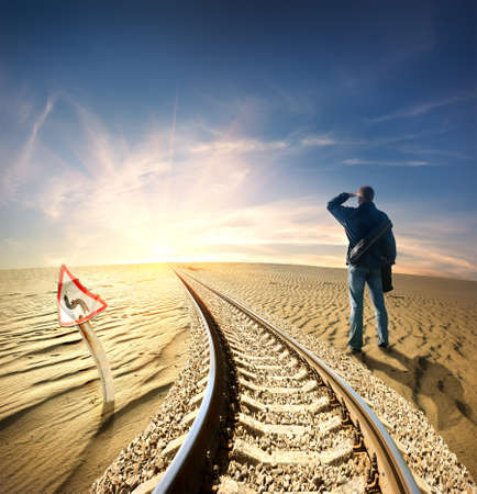 thirsty: Man and railway in desert