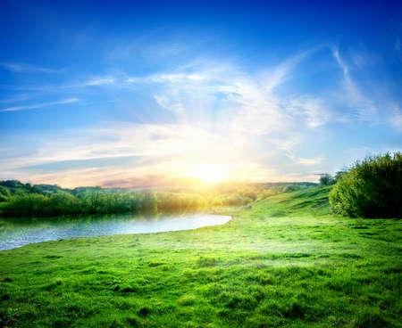 川と太陽と春の風景 写真素材