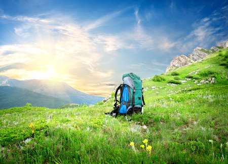 Backpack in mountains Stock Photo