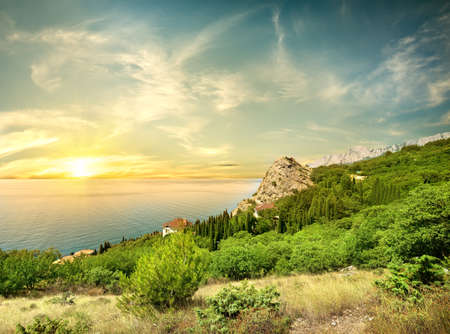 rock iphigenia kastropol: Beautyful sunrise in the sea Stock Photo