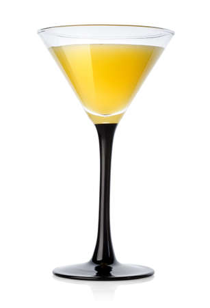 dinnerware: Yellow cocktail in a glass isolated on a white background