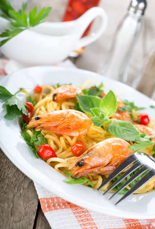 shrimp boat: Seafood spaghetti with prawns on a wooden table