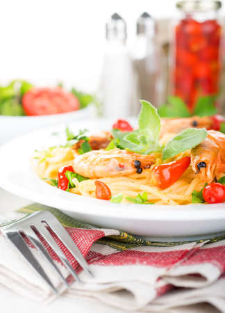 Spaghetti with prawns, herbs and hot pepper Stock Photo