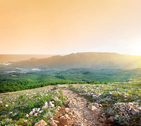 Looking at the sunrise from the top of a mountain Stock Photo - 21618365
