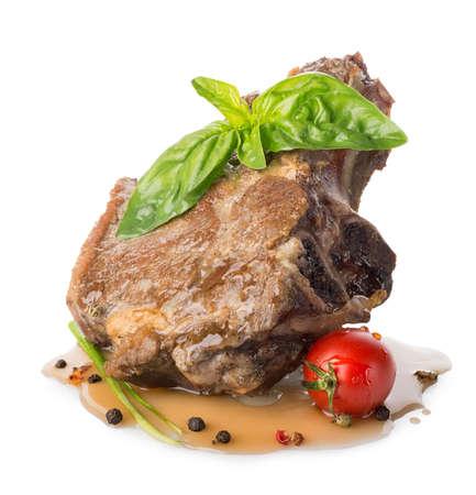 Roasted meat on the bone isolated on white photo