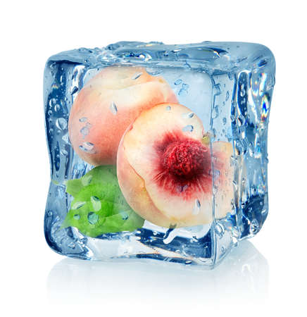 Ice cube and peach isolated on a white background photo