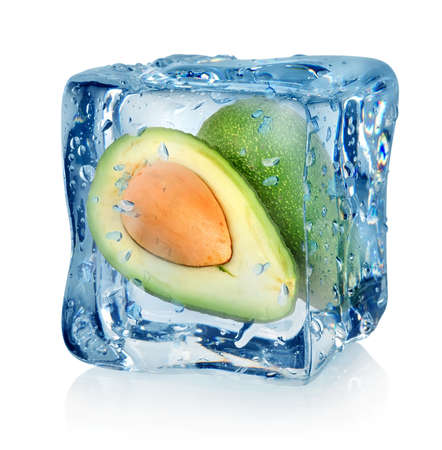 Avocado in ice cube isolated on a white background photo